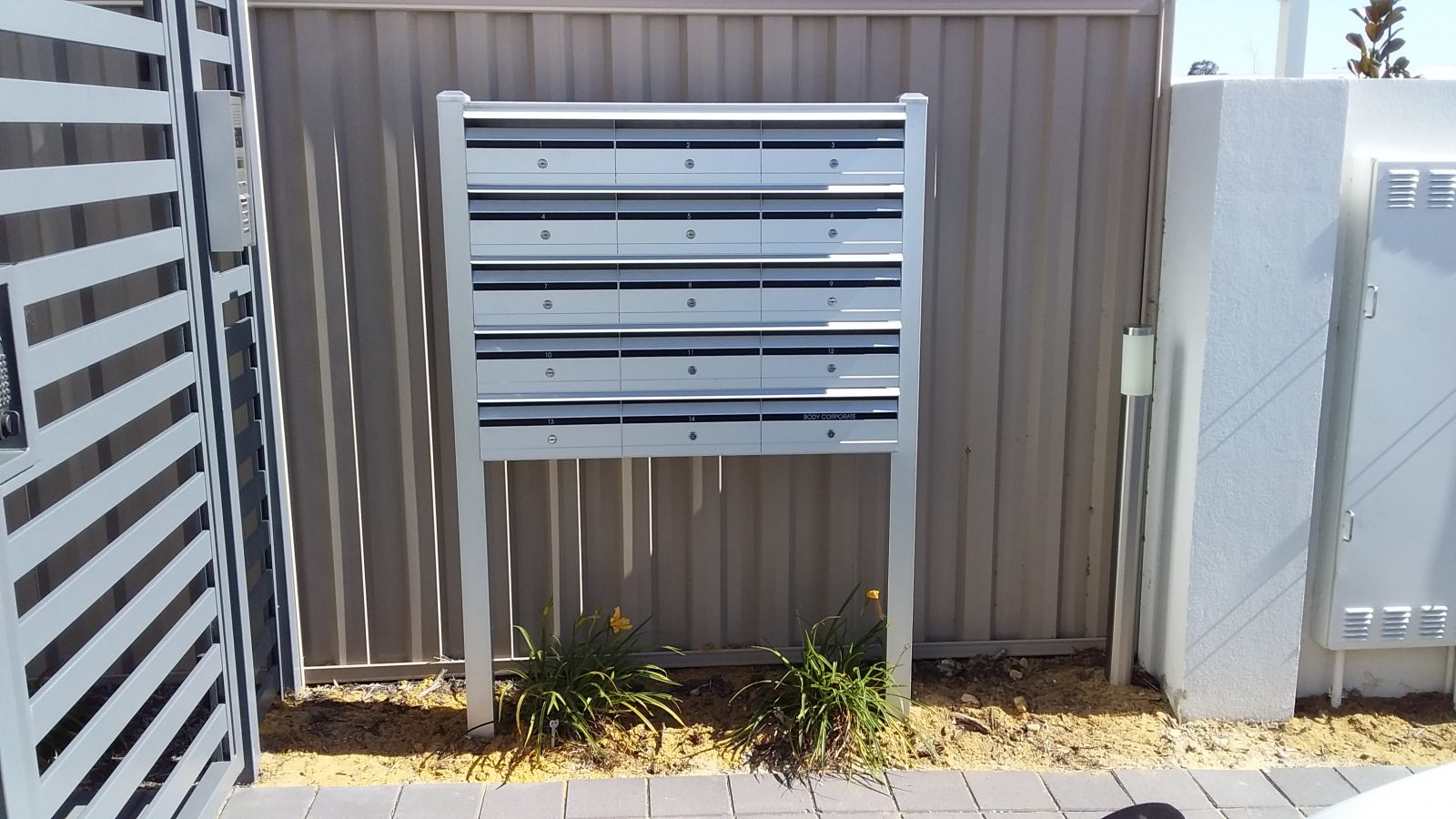 White letterbox cluster on posts